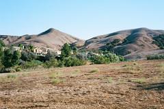 Nested in Hills (markjwyatt) Tags: chinohills california hills houses trees grass field sky contaxiia sonnar50mmf2 ektar100 film