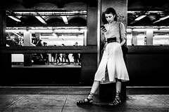 The New Yorkers - Waiting for a train (François Escriva) Tags: nyc ny new york street photography us usa candid people olympus omd girl woman dress phone subway tube metro beautiful pretty cute monochrome black white bw noir blanc nb photo rue streetphotography