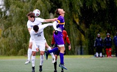 Just a nudge in the back (stephencharlesjames) Tags: college sports soccer ball sport header rain middlebury vermont williams ncaa