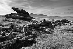 The Logan Stone Noir (Christian Hacker) Tags: loganstone belstonetor dartmoor nationalpark devon landscape child boy scrambling irishmanswall stonewall rockformation blackandwhite bw monochrome mono canon eos50d tamron 1750mm moorland highground distantviews hills granitelandscape boulders rocks kid familyadventure outdoors outandabout nature hiking hike wilderness geology historic