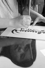 The Calligrapher (peterkelly) Tags: digital canon 6d gadventures transmongolianadventure asia bw mongolia ulaanbaatar winterpalaceofthebogdkhan temple calligrapher calligraphy ink paper writing reflection woman pen hand