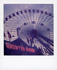 SAXET Haunted House (tobysx70) Tags: the impossible project polaroid slr680 color instant film for 600 type cameras expired generation gen 3 gen3 0416 pioneer member test impossaroid saxet haunted house texas star ferris wheel statefairoftexas midway fair park dallas tx fairground ride gondola neon sign lit illuminated flag silhouette polacon2018 polacon3 092818 toby hancock photography