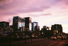 Denver Sunset (Juan Ordonez) Tags: 35mm film analog kodak olympusxa portra 400 color city sky buildings landscape building skyscraper cars car 35mmfilm f28 pink sunset metro denver colorado co