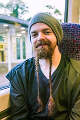 Dans le train (2) (dominiquita52) Tags: streetphotography portrait man homme tresses plaits smile sourire barbe beard stare eyecontact regard