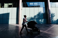 IMG_7444 (JetBlakInk) Tags: magichour minimalist subject2ground women motherandbaby pushchair lightandtone