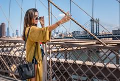 The Bridges and I... (John St John Photography) Tags: brooklynbridge manhattanbridge newyorkcity newyork streetphotography candidphotography woman selfie eastriver skyline cityscape colorphotograph johnstjohnphotography