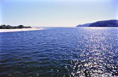 Foz do Sado (pedrik) Tags: seaside film troia river portugal setubal estuary squid beach coast fm2 kodakkodachrome64 gimp fotoxx digitizedbyslr 52442018 nikkoraf24mmf28d