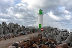 storm (©Andrey) Tags: latvia rix lettonie seaside wave water sun sky clouds lighthouse rocks splash blue grey wind weather nature colour autumn a7rii sel55f18z sonnartfe1855