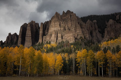 The Cimarrons (Hilton Chen) Tags: aspentrees autumn cimarrons landscape dark colorado overcastsky moody spotlight mountains owlcreekpass fallcolors cimarron unitedstates us