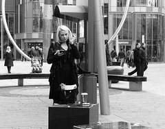 Urban Bliss (Andy WXx2009) Tags: outdoors city cityscape streetphotography people candid bags shopping cardiff blackandwhite monochrome buildings blonde urban wales europe cigarette girl smoking smokers bench beauty fashion woman style femme plaza