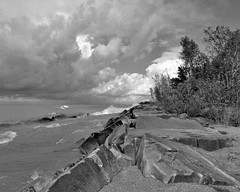 IMG_6765a (rudyschnick) Tags: monochrome bnw clouds sky waves water rocks
