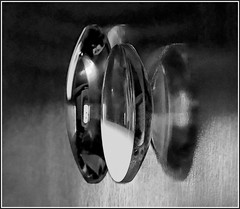 lenses - black & white version (vernon.hyde) Tags: lens pairoflenses convexlens reflection refraction
