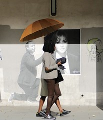 hi ladies ! (cathynoiret) Tags: rue street wall mur color couleur parapluie umbrella women femmes paris orange light lumière ombre shadow art