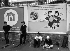 Uncle Ho's Children (solas53) Tags: vietnam street skateboard people poster candid bw blackwhite monochrome casual skater