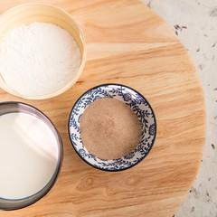 Potato starch, flour and milk (annick vanderschelden) Tags: weigh bowl decorative kitchenscale lazysusan wood lighteffect food ingredient maltodextrin ryemeal e150c polymer potatostarch starch milk flour baking miseenplace belgium