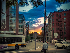 Sunset over Mount Auburn Street (briburt) Tags: briburt olympus lumix micro43 microfourthirds omdem5mkii 25mm mt auburn street harvarduniversity harvard light color painting blur lines eerie ghost ghostly dramatic filmsimulation motion energy contrast massachusetts abstract red yellow green trees park cambridge newengland movement buildings traffic bus transportation sun car pedestrian sunset dusk architecture urban city bigcity road sky people clouds intersection building tree horizon streetscape cityscape streetphotography