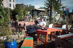 Relaxing... (Oregami) Tags: eastlondon fagandphone mobilephone nomadiccommunitygardens relax shoreditch smoking streetphotography upcycling stphotographia
