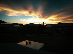 The Glass Table (Steve Taylor (Photography)) Tags: ornament building garage house table contrast glass newzealand nz southisland canterbury christchurch northnewbrighton reflection silhouette sunset sundown sun sky cloud