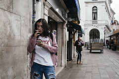Levi's girl. (markfly1) Tags: venice italy girl smoking cigarette levi t shirt cool kid woman walking shot layer streetphoto candid image pink blue red beige desaturated classic old school film look digital photo nikon d750 35mm manual focus lens daylight subtle light style class ripped torn jeans fashion colour color italia cute pretty