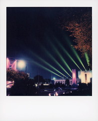 State Fair Nights 2 (tobysx70) Tags: the impossible project tip polaroid sx70sonar sonar expired instant color film for sx70 type cameras impossaroid state fair nights statefairoftexas esplanade park dallas texas tx reflecting pool wet reflection floodlights lit illuminated night nocturnal pink magenta yellow trees polacon2018 polacon3 092818 toby hancock photography