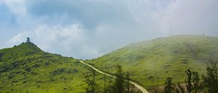 Ponmudi hills, kerala, India (muditbisht96) Tags: india kerala trivandrum ponmudi hills landscape green grass trees nature path watchtower blue sky clouds fog mountains forrest nikon d5200 tamron18200mm tamron telephoto panorama