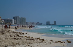 On the beach in Cancun / На пляже в Канкуне (Vladimir Zhdanov) Tags: travel mexico yucatan landscape cancun sea sky skyscraper people beach sand water wave