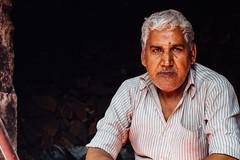 Indian Shopkeeper, Portrait, Baldeo Uttar Pradesh (AdamCohn) Tags: 013kmtobaldevinuttarpradeshindia adamcohn baldeo baldev india uttarpradesh geo:lat=27407964 geo:lon=77822270 geotagged holi man portrait wwwadamcohncom