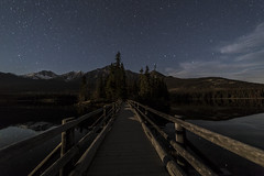 Pyramid Lake Bridge (Terry L Richmond) Tags: dawn mountain sky landscape snow night water evening tree dusk bridge noperson outdoor nature travel rail sunset atmosphere moon star track darkness outerspace light railing pier astronomicalobject horizon dark outdoors standing black moonlight board meteorologicalphenomenon midnight air pyramidlake jaspernationalpark