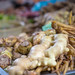 Bokeh Photo of Ginger surrounded by Carrots and other Vegetables