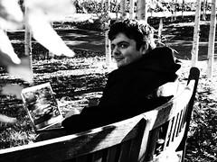 Josh Working at University (cycle.nut66) Tags: josh student university reading bench outdoors outside grainyfilmartfilter olympusepl1 evolt micro four thirds mzuiko laptop cpomputer styudying trees black white monochrome grayscale