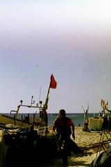 Praia de Monte Gordo (leonorbarroso) Tags: minolta x700 analog film portugal beach fisherman