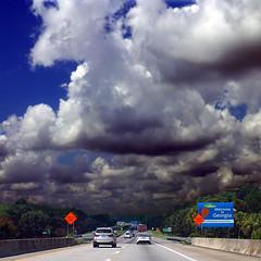 Welcome to Georgia, USA (pom'.) Tags: panasonicdmctz30 july 2018 america northamerica usa unitedstatesofamerica southcarolina georgia charleston fromamovingvehicle savannah highway jasperhighway toyotaprius sky clouds 100 200 americanwayoflife 300