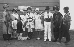 Dressing up time (theirhistory) Tags: boy children kids girl jumper jacket shirt shoes wellies shorts wellingtons