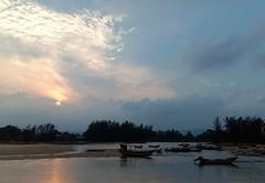 sunset on the east coast (SM Tham) Tags: asia southeastasia malaysia terengganu eastcoast kemasik kemasikriver river water fishingboats trees reflections sunset evening sky clouds sun calm serene peaceful landscape