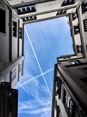 Looking up. From Paris, 6ème. (BadGunman) Tags: mur bleu blue lines stripes graphic wall france paris plane contrail contrails sky up