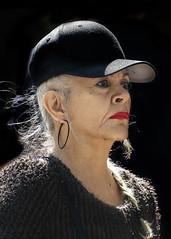 Portrait (D80_520301) (Itzick) Tags: manhattansep2018 candid color colorportrait hat woman portrait lipstick earrings blackbackground streetphotography d800 itzick