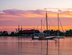 Sailboat (✦ Erdinc Ulas Photography ✦) Tags: boat sailboat ship wood water reflection colourful sunset hoorn city bay harbour nederland netherlands holland dutch building purple yellow clouds sky panasonic flag vlag boot zeilboot