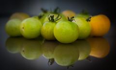Knowledge ... (vanessa violet) Tags: greentomatoes tomatoes greentomato green tomato fruit reflection colourfusion greenshouldbeseen knowledge wisdom