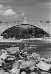 Bridge arch (sam.naylor) Tags: italy europe travel medium format film fuji nature mountain mountains hills countryside medieval history stone bobbio town ancient street summer warm 35mm contax g1 rangefinder colour viaduct sky bridge black white monochrime grey ilford fp4