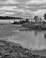 IMG_7056a (rudyschnick) Tags: monochrome bnw beach water sky clouds