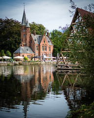 Minnewater Castle (jameslf) Tags: autumn belgium bruges brugge castle flanders historic lake medieval minnewater reflection town water