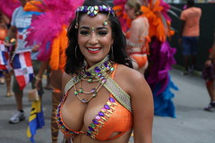 dynamite package (Chuck Diesel) Tags: miamicarnival2018 sexy masquerader costume people woman parade bigtitties cleavage curves breasts tanlines hot smile boobs