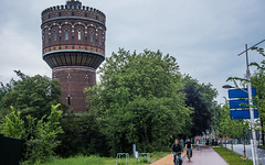 2018 - Delft - Water Tower (Ted's photos - For Me & You) Tags: 2018 cropped delft nikon nikond750 nikonfx tedmcgrath tedsphotos vignetting thewatertower thewatertowerdelft watertower delftwatertower watertowerdelft people peopleandpaths pathsandpeople pathway bikers bicycles tower