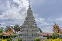 Monument in the Royal Palace Complex in Phnom Penh (wuestenigel) Tags: bird monument paintings phnompenh cambodia royalpalace temple cloudysky buddha architecture diearchitektur tempel religion wat was travel reise spirituality spiritualität noperson keineperson pagoda pagode ancient alt traditional traditionell stupa spalte building gebäude worship anbetung gold sacred heilig culture kultur sky himmel sculpture skulptur monastery kloster