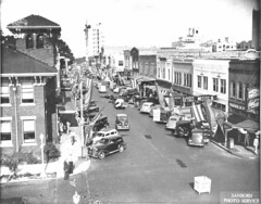 Decorated Main Street (lakelandlibrary) Tags: hotels commercial district automobiles downtown