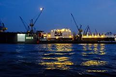 Blaue Stunde. (Summer Jay) Tags: fujixt2 fuji germany hamburg night summer evening coloryellow colorblue warerfront water cranes ships harbour bluehour