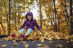 Endless smiles (Elizabeth Sallee Bauer) Tags: active autumn beautyinnature boy child childhood fall fun jumping kid leaves outdoors outside playing trampoline trees youth