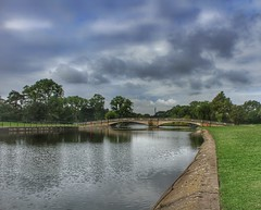 Happy Saturday!😊👍 (LeanneHall3 :-)) Tags: bridge lake reflection green grass trees branches leaves grey white clouds talkativeclouds cloudsstormssunsetssunrises eastpark hull kingstonuponhull landscape skyscape canon 1300d groupenuagesetciel