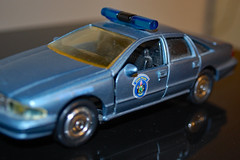Die Cast Patrol Car. (dccradio) Tags: lumberton nc northcarolina robesoncounty car copcar policecar policecruiser statepolice statetrooper mainestatetrooper chevy chevrolet caprice cruiser indoor inside indoors tire tires wheel door doors reflection lightbar lawenforcement law diecast toy model replica 1996 blue vehicle transportation squadcar nikon d40 dslr