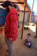 Watching Uncle Matt (quinn.anya) Tags: sam paul toddler kindergartener watching renfaire renaissancefaire norcalrenfaire northerncaliforniarenaissancefaire